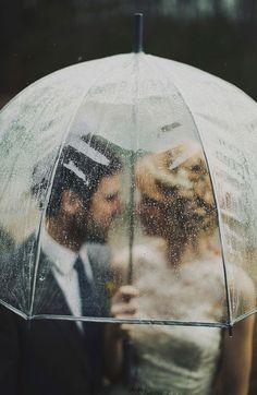 photo through a clear umbrella on a rainy wedding day
