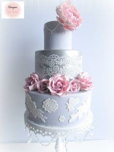 3 tiered Wedding Cake with a lustred middle tier. A single peony and Roses.
