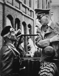 Adolf Hitler conversing with Karl-Jesko von Puttkamer, in leather greatcoat with…