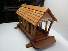 "Covered Bridge Bird Feeder! Custom and homemade from cedar and hardwood, with cedar shingled roof, waterproofed w/weather sealant. Very lightweight for hanging or on a post yet very strong and durable. Measures 27"" long, 9 1/2"" wide and 14' high. Built from photos taken of a covered bridge in New Hampshire named ""Mom's Creek Bridge"". Asking $45. Many other custom handcrafted items available. Located in Surry. Email yachtwatcher3@hotmail.com or call Gary Beal 812-2018 (mobile)"
