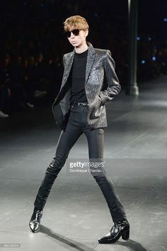 model walks the runway during the Saint Laurent Menswear Fall/Winter...Click to see more