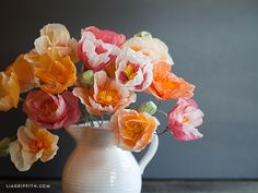 Easy to make with tissue paper and a few craft supplies and tools, these cheerful poppies make a perfect gift or decorate your dining room table.
