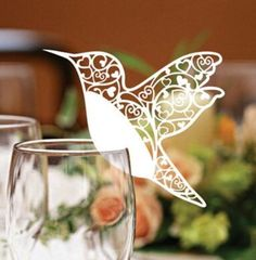 Cute bird table name cards resting on the glasses. Love this!