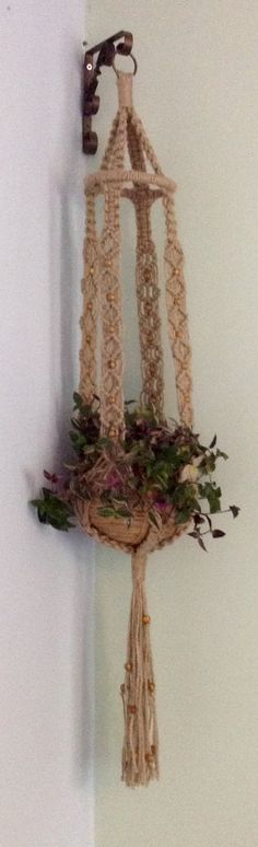 MAKRAME MAGIK CHUNKY 4 BEAUTIFUL HANDCRAFTED MACRAME PLANT HANGER HANDCRAFTED & DESIGNED IN THE U.K. BY KATHRYN I use 100% natural materials & the hanger is natural in colour. It comes with an attractive wooden bead detail. The approximate length including fringe is 42 & the pot