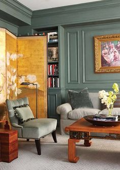 Gold folding screen in gray green room