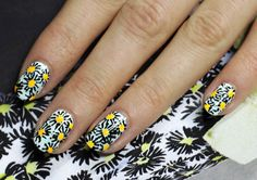 Runway-inspired floral nail art tutorial by Sophie Harris-Greenslade (The Illustrated Nail).  Black and yellow blooms...cute!