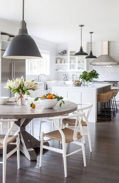 I love this kitchen/dining set up! I Love the subway tiles, round table, and crisp, Wishbone chairs! Shop this look at SmartFurniture.com