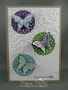 Stamp Sets:  Papillon Potpourri, Teeny Tiny Sentiments  Ink:  Perfect Plum, Versa Mark with White Embossing Powder  Card Stock:  Crumb Cake, Whisper White, Perfect Plum, Wild Wasabi, Baja Breeze  Accessories:  Elegant Lines Embossing Folder, Delicate Doilies Sizzlits, Rhinestone and Pearl Basic Jewels, Vintage Faceted Designer Buttons, White Baker's Twine, Elegant Butterfly Punch, Dimensionals.