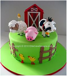 Farm animals in a barn yard birthday cake