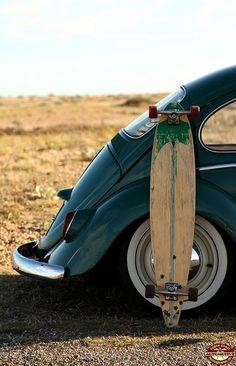 Classic vw beetle and longboard skateboard