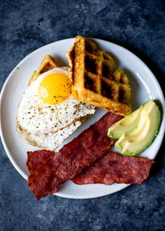 A savory breakfast featuring honey jalapeno zucchini cornbread waffles. Delicious, filling and perfect when topped with a fried egg & turkey bacon!