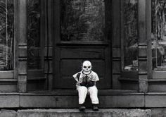 Cincinnati's Halloween history. Photo: Eric James Short, 5, of Covington, sits in front of his father's deli after coming home from a Halloween party in 1977. The Enquirer/Ed Reinke