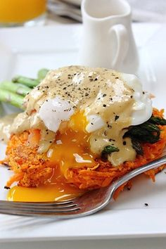 Super Fancy Smoked Salmon Stack. With a sweet potato cake (Rosti), poached egg, asparagus, and cashew hollandaise sauce.