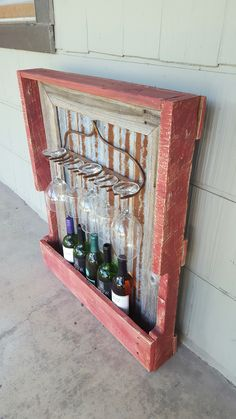 Rustic wine rack from pallet wood, barn tin, fence pickets and rusty rake head. Mounts to wall. $75 on Etsy