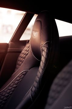 Many signs are merely accessories to a greater product or concept.  Aston Martin for example, used their logo on even the headrests of their cars. The design of the seat with the logo signifies luxury and status.  If your car has sleek leather seats with the logo stitched into it you know it must be a nice car.