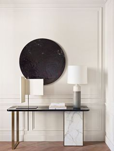 A glazed lava stone artwork by Jean-Baptiste Bernadet hangs in the master bedroom. The console is by Studio 63 for Marioni Apartment Entryway, Parisian Apartment, Paris Apartments, Best Interior Design Websites, Luxury Interior Design, Interior Architecture, Nordic Interior, French Interior, Luxury Home Furniture