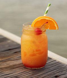 Planter's Punch (2 parts dark rum 2 parts orange juice 2 parts pineapple juice 1/2 part lime juice 1/2 part lemon juice Splash of grenadine)
