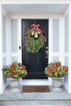 Our Christmas door swag and holiday planters - full tutorial included in post! Outdoor Christmas Planters, Christmas Urns, Front Door Christmas Decorations, Christmas Time, Christmas Ideas, French Christmas, Outdoor Decorations, Christmas Stuff, White Christmas