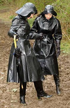 Policewomen Nell Hastings and Laura Sanders confer about what they see in the mud.