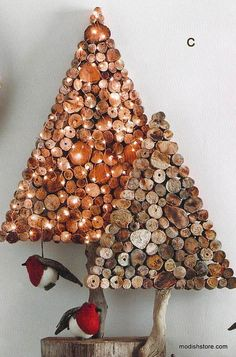 Slices of reclaimed Roost's Driftwood gather for holiday festivities in wreath and tree forms. Trees stand on driftwood branch trunks and the wreaths come with hanging (Unique Christmas Ideas) Noel Christmas, Rustic Christmas, All Things Christmas, Christmas Ornaments, Homemade Christmas, Christmas Lights, Driftwood Christmas Tree, Christmas Projects, Holiday Crafts