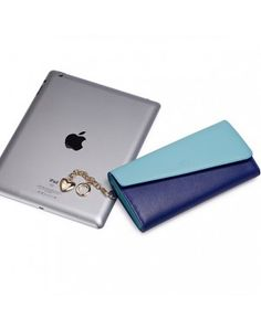 This #stylishwallet contains PU Material with Brand jacquard lining Inner material and Zipper Opening and 10.5 cm Bag length 19.5 cm Bag height. In this available colors are #blue with Inner structure: 8 locations for cards, 3 locations for the organ and a zipper pocket