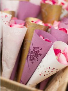 Put rose petal is hand made cones for your guests to toss at you as you walk back down the aisle as a married couple!!