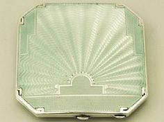 A fine Art Deco style antique George VI English sterling silver and guilloche enamel compact.