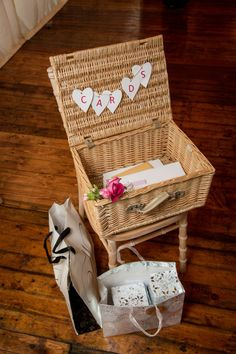 Such a pretty way to store cards at a wedding reception. Find similar baskets here http://www.virginiahayward.com/wicker-baskets/