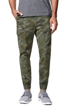 Bullhead creates a camo pair of men's jogger pants found at PacSun. TheTraditional Cargo Jogger Pants for men supply comfort and function thanks to the cargo pockets, elastic waist, and Bullhead logo above the welted back pocket.Camo jogger pantsBullhead logo above welted back pocketSlant front pocketsElastic, drawstring waistCargo pocketsMachine washable98% cotton, 2% spandexImported