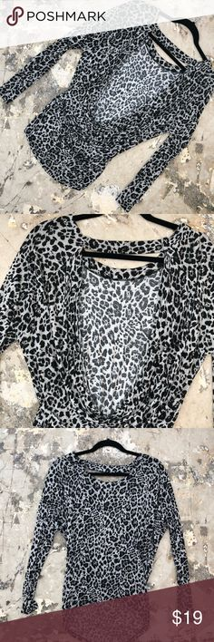 Express low back cheetah shirt Express long sleeve cheetah shirt. Material is lightweight allowing this top to be worn in any season. The back is longer then the front. The back is exposed giving the shirt a feminine and sexy look. A versatile piece that can be worn with jeans or that mini skirt in your closet! Express Tops Tees - Long Sleeve