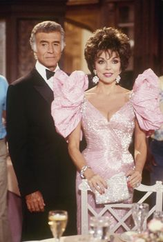 those sleeves! Joan Collins was a barracuda in pink!