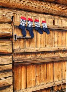 Marius-socks on a old door, Norway