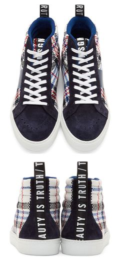 Navy Woven Plaid High-Top Sneakers by MSGM. Textile slip-on shoes in navy, white, red, and black. Plaid pattern woven throughout. Round toe. White lace-up closure. Navy suede trim at eyerows, tongue, toe, and heel. Brogue detailing at toe. Padded collar. Textile trim and pull-tab at heel in black with printed text in white. Thermal film stripe applied at outer side in navy. White rubber sole. Tonal stitching. Upper: textile. Lining: leather. Sole: rubber. Made in Italy ...