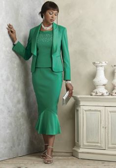 Evita Skirt Suit from ASHRO - Jacket has wide lapels that extend to waist and two angled faux besom pockets. Scoop-neck tank is accented with rhinestones and has side zipper.