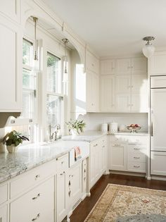 satin nickel white kitchen.  Love everything about this kitchen.  Small cabinets stack 3 high - would like a knob and latch - old style for hardware.