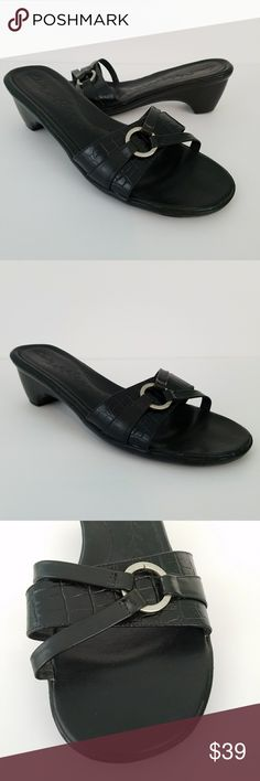 "Clark's Black Leather Brazil Slip On Sandals 8 M Brand: Clark's  Condition: Excellent Color: Black Style: Slip on Sandal Material: Leather  Size: 8 M Heel Height: 2"" Insole: 10"" Cute silver buckle decoration Made in Brazil Smoke Free Environment: Yes   Thank you for stopping by! I hope you'll find something you love in my closet! Please let me know if you have any questions.... Much love,  Christine Clark's Shoes Sandals"
