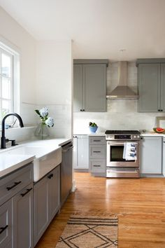 Busy professionals with two young kids, Liz Flynn and Craig Howe lived in their 1927 Silver Lake bungalow for eight years before kitchen hardware Small Kitchen Cabinets, Galley Kitchen Remodel, Grey Cabinets, Painting Kitchen Cabinets, Kitchen Cabinet Design, New Kitchen, 1950s Kitchen, Condo Kitchen, Apartment Kitchen