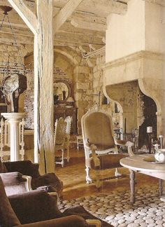 beautiful room - love the stone wall, archway and the massive fireplace
