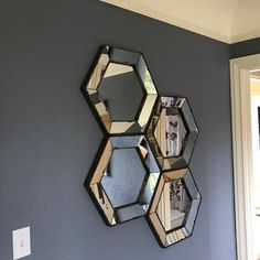 Inspired by fine vintage markets and bustling bazaars, this antique-inspired wall mirror features a hexagonal silhouette and mercury glass-style frame. Its timeworn design offers that coveted heirloom looks for your living room, parlor, or den.