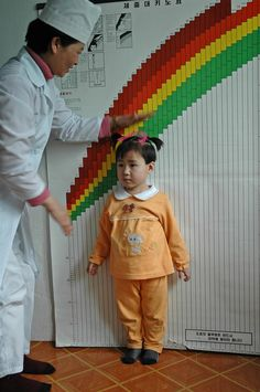 A nurse at the Wonsan City Baby Home, a state-run orphanage in Wonsan City on the south-eastern coast of the Democratic People's Republic of Korea, measures a girl against a UNICEF-supplied growth monitoring chart. UNICEF is working with the Government to find alternatives to institutional care for orphans or children abandoned by their parents.  © UNICEF/Dan Thomas  http://www.unicef.org