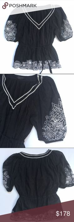 BCBGMaxAzria Black & White embroidered Boho Blouse BCBGMaxAzria black & White embroidered Boho Blouse with v-neck and cinched drawstring waist. Beautiful floral pattern embroidery. Size Small. Cotton with lining. BCBGMaxAzria Tops Blouses