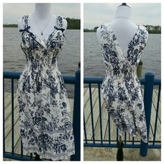 Beautiful Classic Design Summer Dress This dress is very well made. It comes with a slip lining and a padded top so a bra is not needed. Shell is 100 % cotton and the lining is 100% polyester. Machine wash cold or dry clean. New without tags. Sheri Martin Dresses