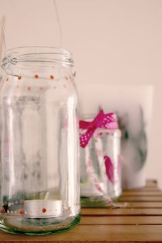 DIY- decorated jam jar candle holders. Decorate with ribbon and DIY paint ....Stensils can also be used
