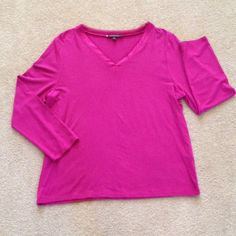 Anne Klein Long sleeve v-neck magenta top Dress up or down. 95% modal, 5% spandex. V-neck has satin-like trim with tulle detail. Pre-loved. Very good condition. I detect no flaws. Made in Vietnam. Machine wash. Anne Klein Tops