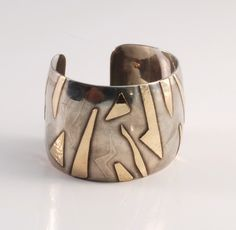 Silver and gold cuff.  Designer unknown.  #jewellery  #modern  #silver  #gold