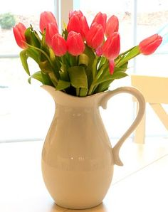 I love a white pitcher as a vase for the table...