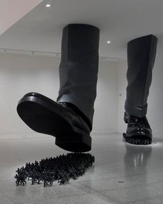 This work called Karma is by the Korean sculptor and installation artist Do Ho Suh.