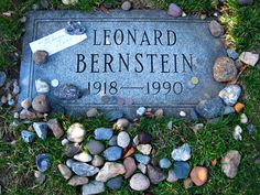 """People leave things on graves all the time – especially famous graves. Leaving pebbles/stones is a Jewish custom, but I have seen many other things. The note on Saturday said """"We'll catch up some other time. (heart) E.C. & T. M."""