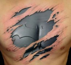 Is this ripped off tattoo showing a Batman armor underneath is real???
