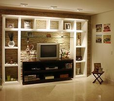 Stone Wall Behind White Entertainment Unit along with darker color TV stand. White Entertainment Unit, Interior Design Living Room, Interior Decorating, Sweet Home, Muebles Living, Home Tv, Living Room Tv, Home Furnishings, Diy Home Decor